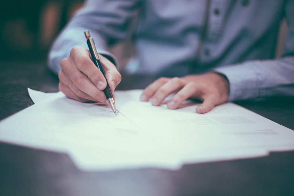Man Signing Papers | Moseman Law Office, LLC